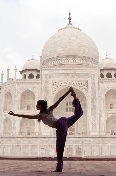 young female practising yoga pose king dancer or natarajasana - mahroch stock pictures, royalty-free photos & images