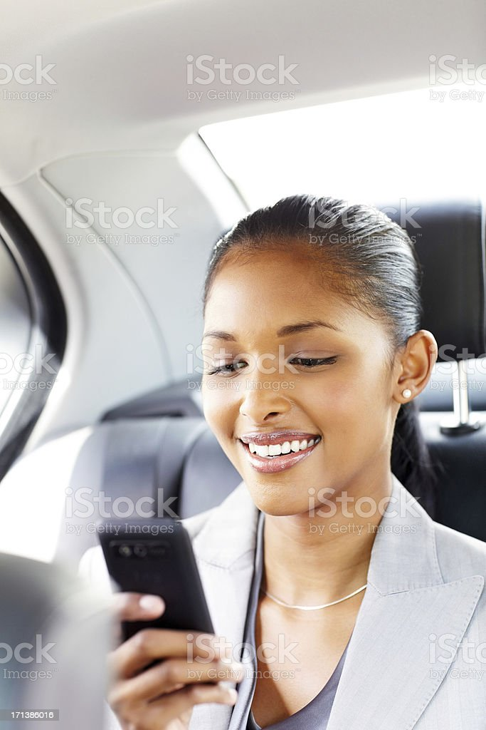 Young Female Professional Reading Text Message royalty-free stock photo