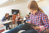 istock Young female pupil stubbornly writing 639183710