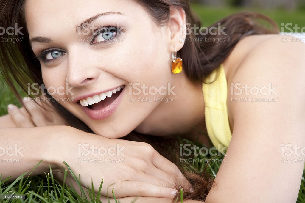 Young female relaxing in the grass royalty-free stock photo