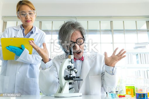 1147277006 istock photo Young female research scientist and Senior male professor researchers working in life scientific laboratory. 1178360707