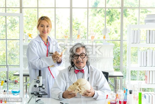 1147277006 istock photo Young female research scientist and Senior male professor researchers working in life scientific laboratory. 1178360736