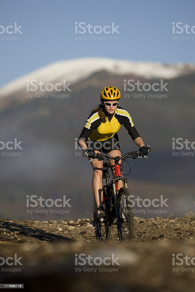 Young Female Riding Bicycle On Rocky Trail royalty-free stock photo