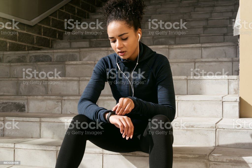 Young female runner checking her pulse stock photo