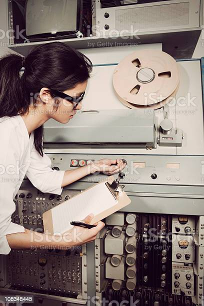 Young female scientist checking computer 60s70s vintage style picture id108348445?b=1&k=6&m=108348445&s=612x612&h=nk34cri3c7t6atkdsp 5d cnge2evx4yq41u0mjrd7m=