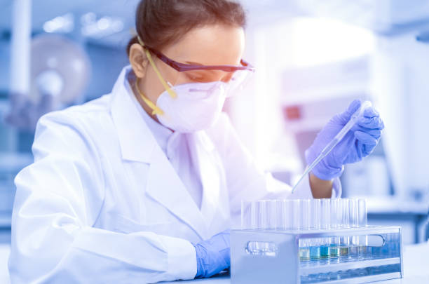 Young female scientist working in the CDC laboratory. stock photo