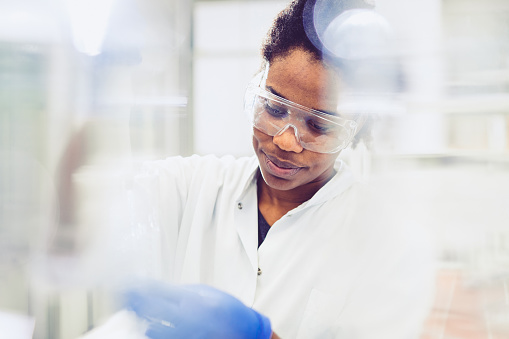 Scientist Using an Automatic Pipette