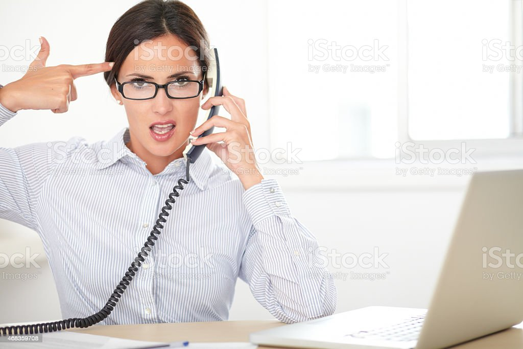 Young female secretary using the phone royalty-free stock photo