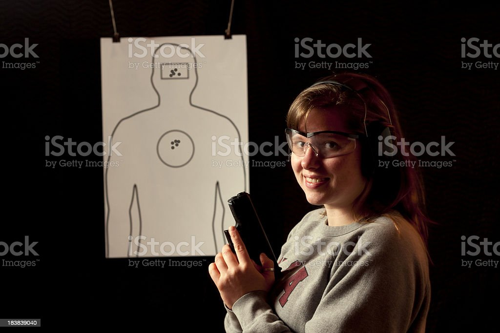 Young Female Shooter - Bullet Holes royalty-free stock photo