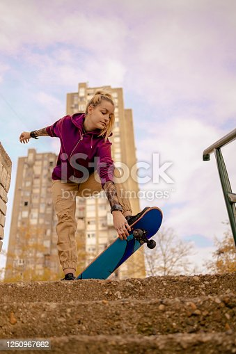 Young female skateboarder jumping