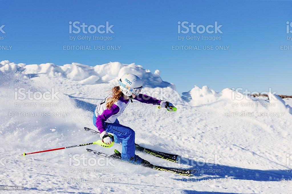 Young female skier in slalom race in snow stock photo