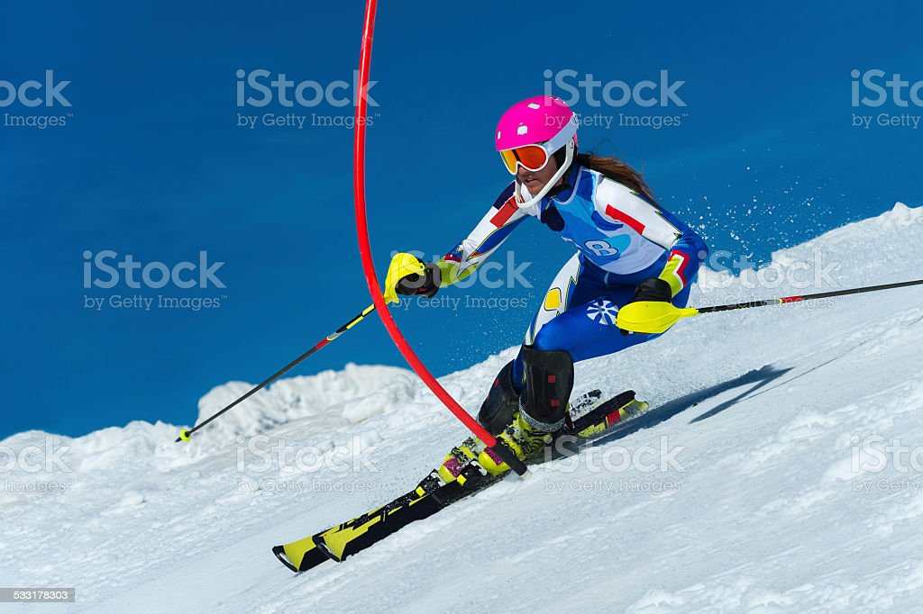 Young female slalom skier during the race stock photo