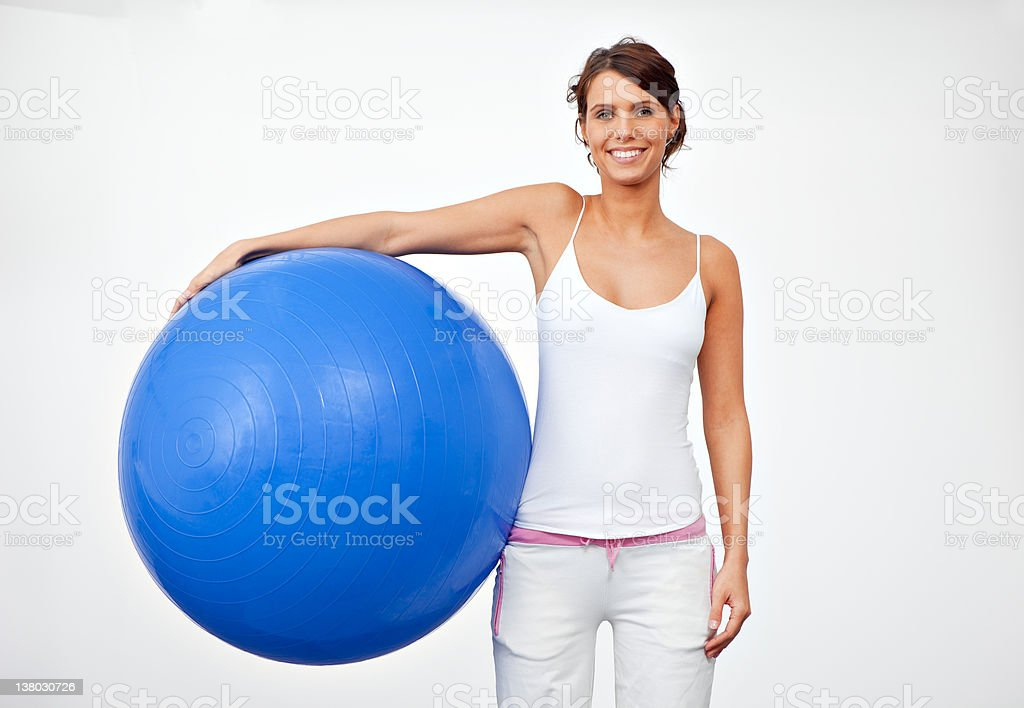 Young female standing with fitness ball royalty-free stock photo