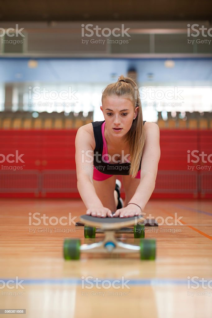 Young Female Stretching Workout in Gym Front Low Angle View royalty-free stock photo