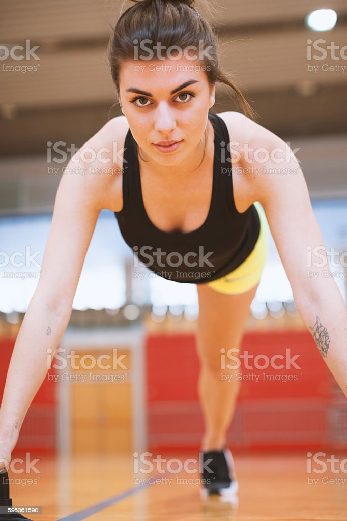 Young Female Stretching Workout Indoors Front low Angle View royalty-free stock photo
