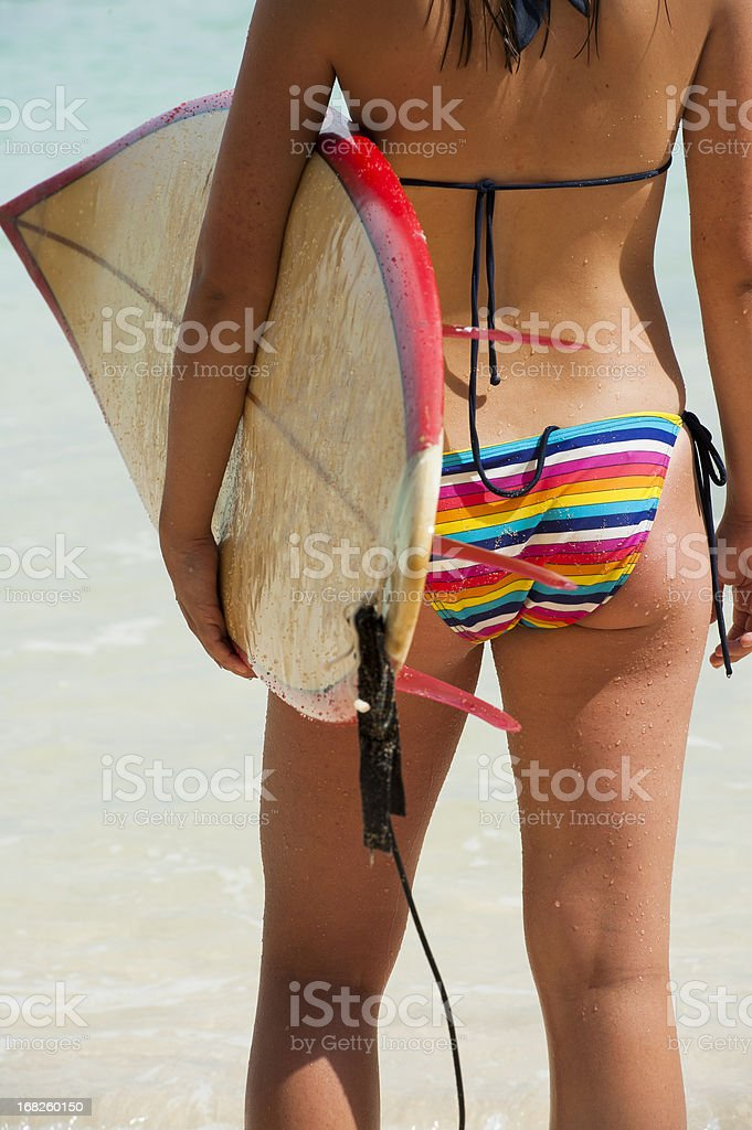 Young female surfer with surfboard stock photo