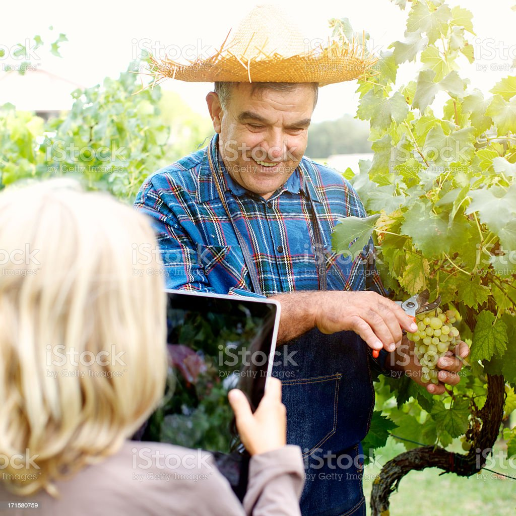 Young female takes photograph of elderly man. royalty-free stock photo