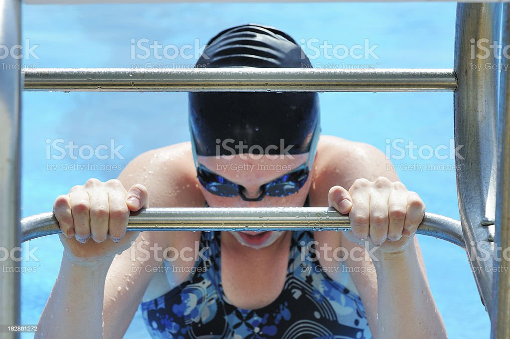 Young Female Teen Athlete Backstroke Swimmer Ready at Race Start royalty-free stock photo