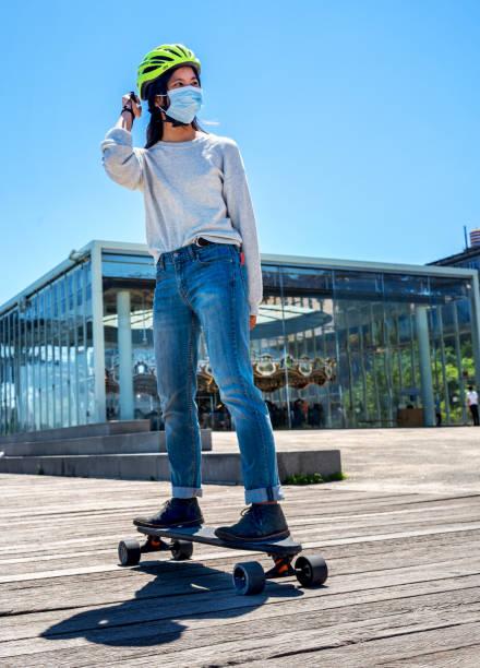 Young female teen skateboarding in Brooklyn