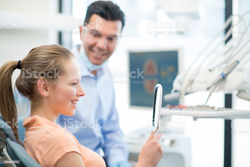 Young Female Teenager at the Dentist stock photo