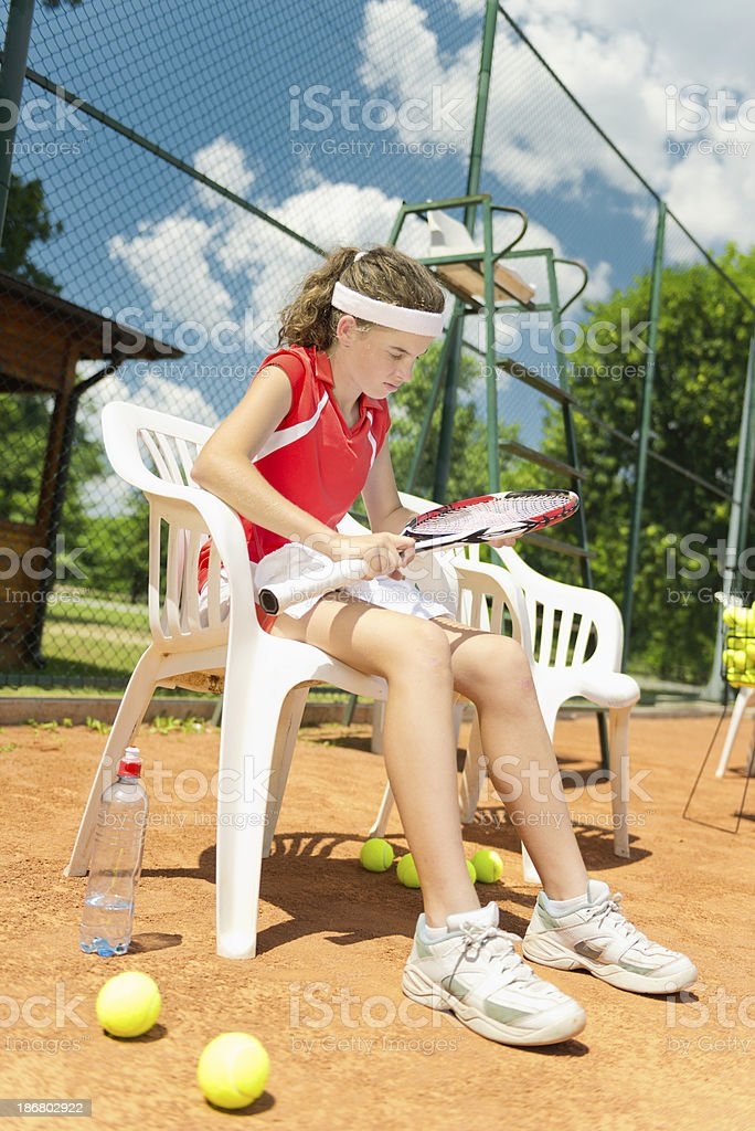Young female tennis player on break royalty-free stock photo