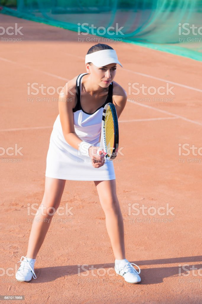 Young Female tennis Player Preparing for a Play. Lizenzfreies stock-foto
