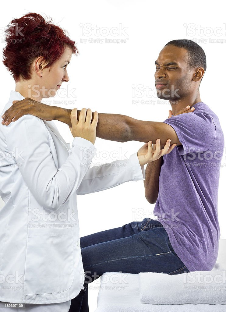 Young female therapist helping male patient royalty-free stock photo