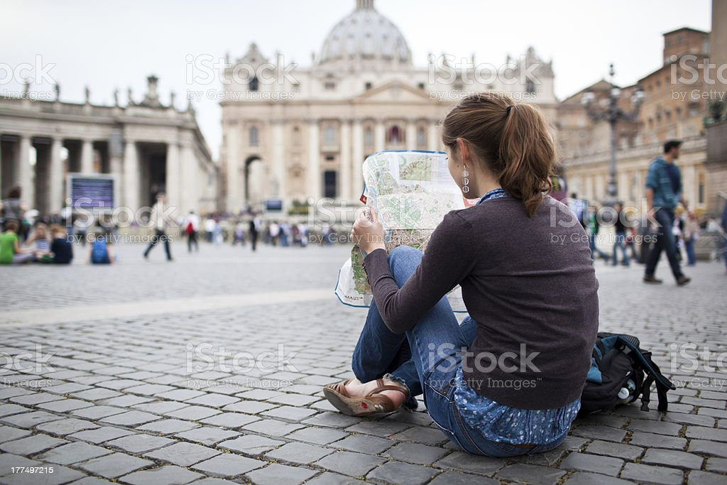 Young female tourist at St. Peter's square stock photo