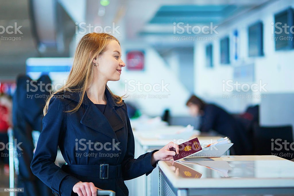 Young female traveler in international airport stock photo