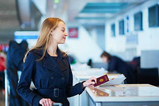 young female traveler in international airport - airport check in counter stock pictures, royalty-free photos & images