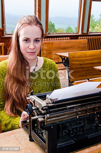 158326970 istock photo Young female typing 516102392