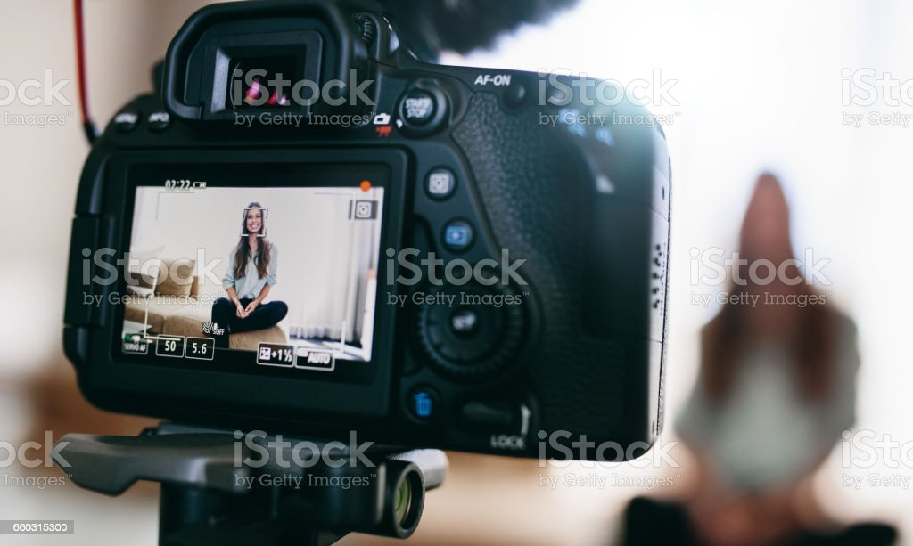 Young female vlogger on camera screen. stock photo