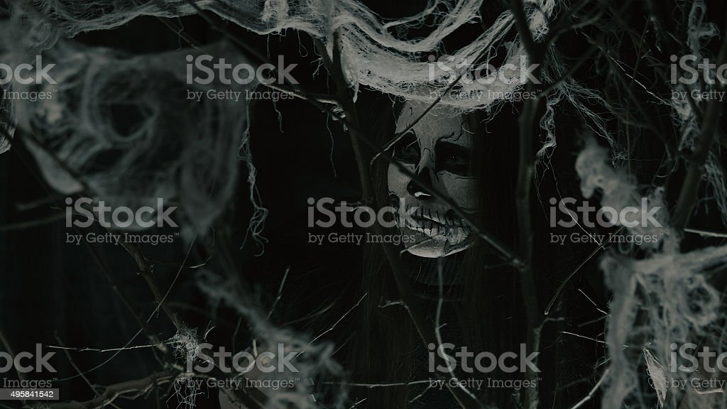 Young female warrior of tribe looking for something stock photo