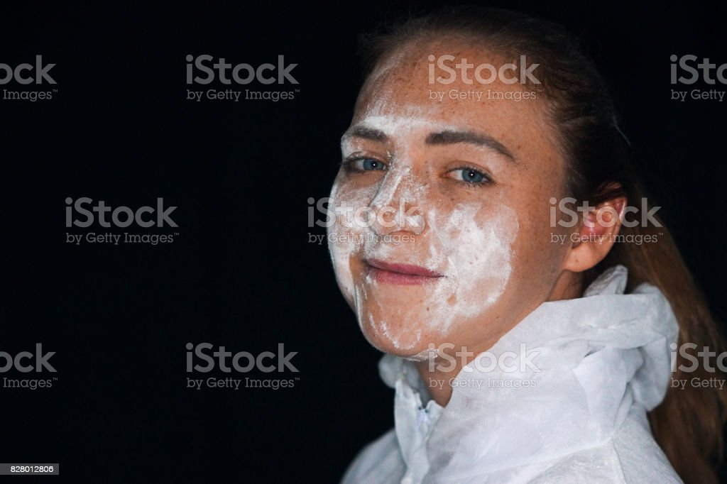 A young female wears a dust suit stock photo