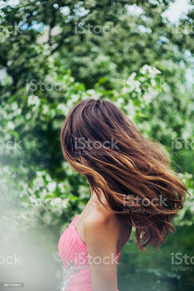 Young female with beautiful long hair in motion stock photo