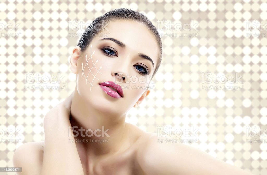 Young female with clean fresh skin, abstract background stock photo