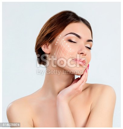 istock Young female with clean fresh skin 518025974