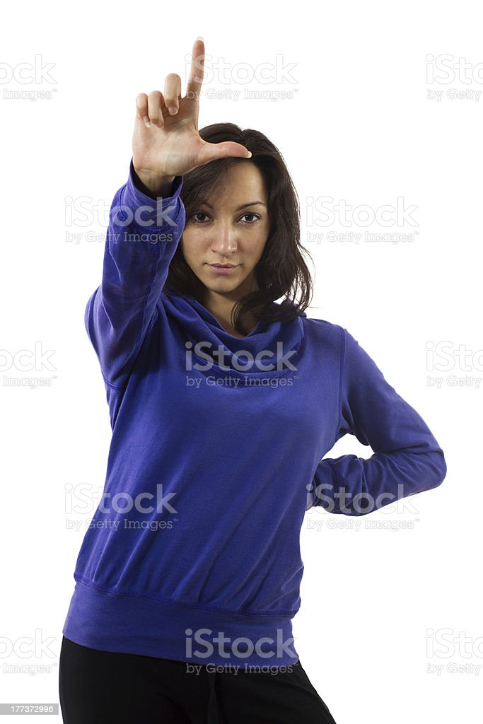 Young female with loser L hand gesture royalty-free stock photo