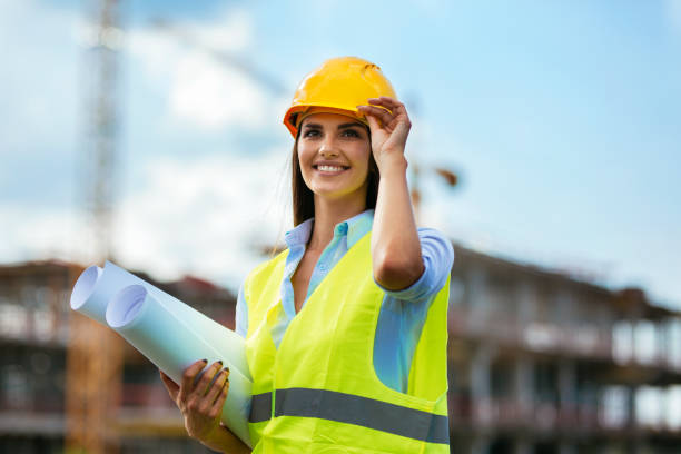 young female worker on consturction site - civil engineer stock photos and pictures