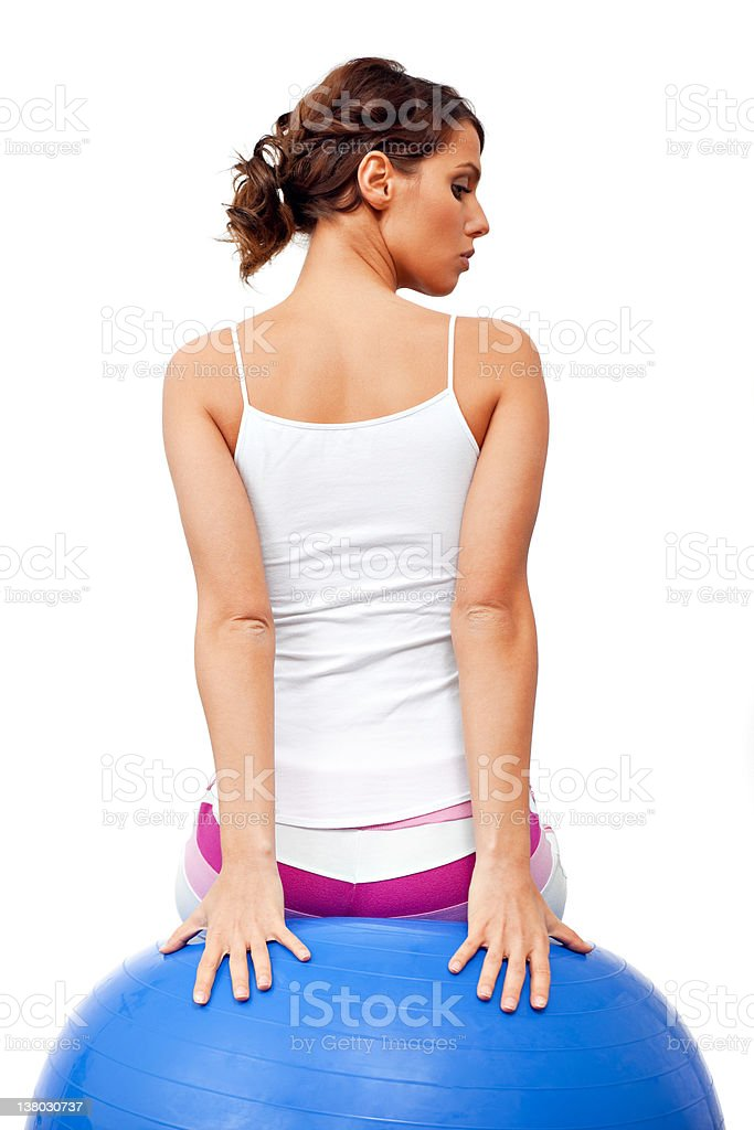 Young female working with fitness ball stock photo