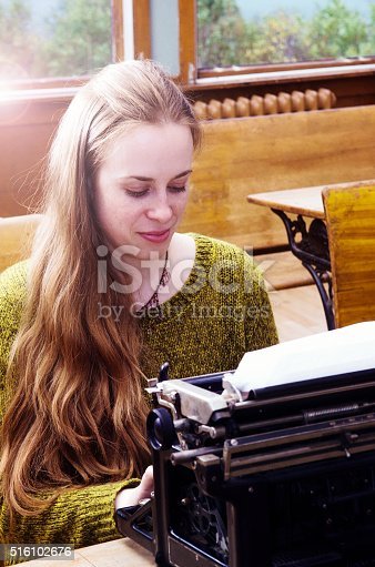158326970 istock photo Young female writer 516102676