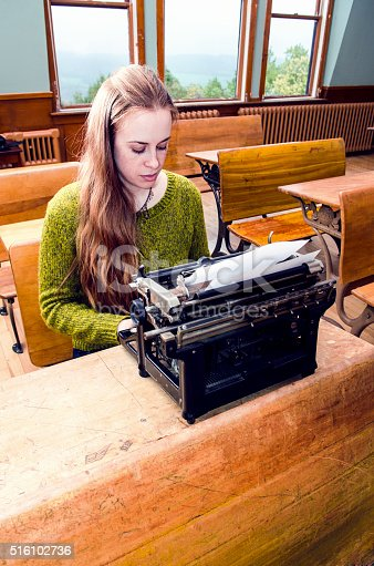 158326970 istock photo Young female writer 516102736