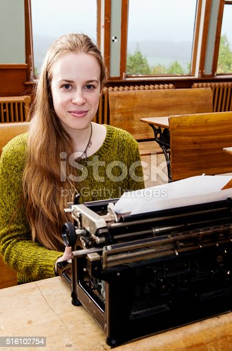 158326970 istock photo Young female writer 516102754