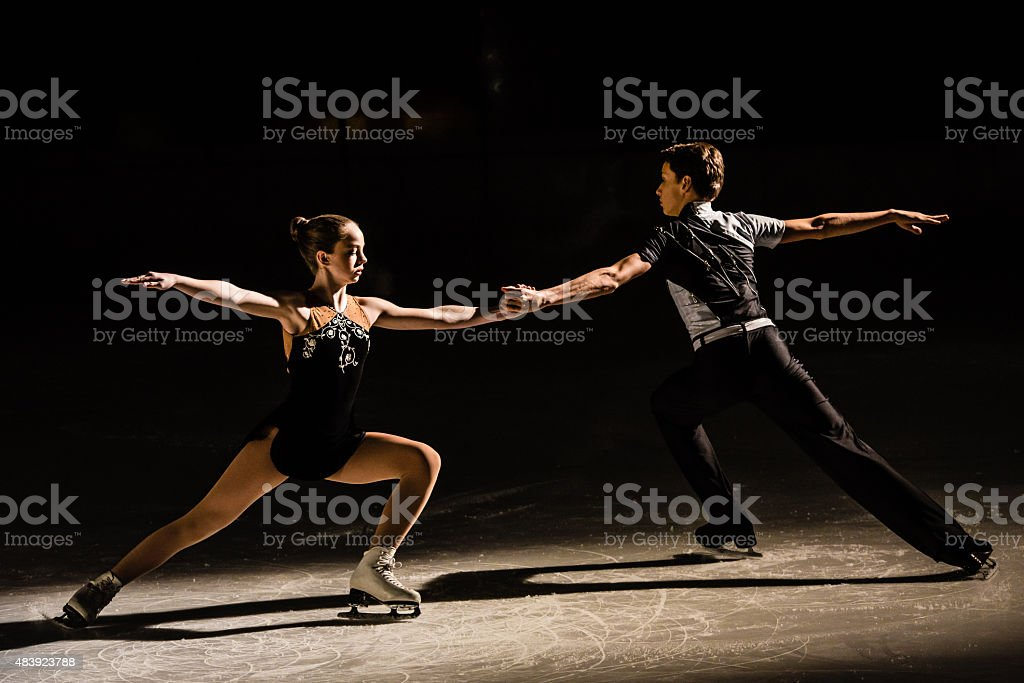 Young figure skating pair performing stock photo