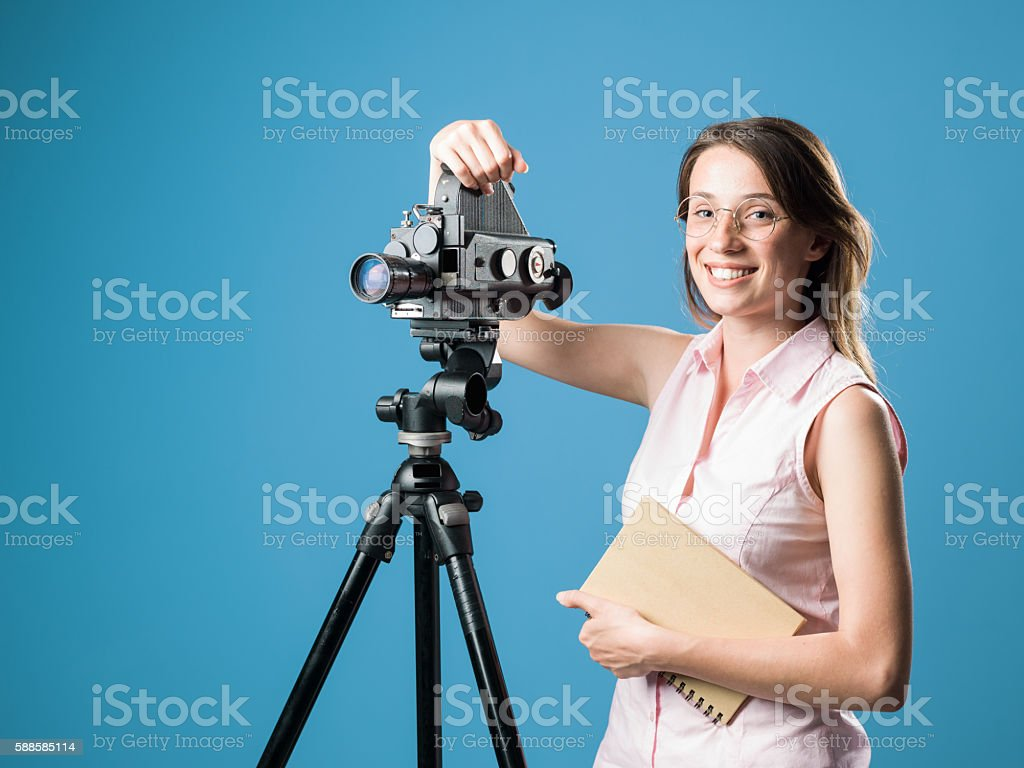 Young Film Director Posing With Her Old Fashioned Camera - Stock image .
