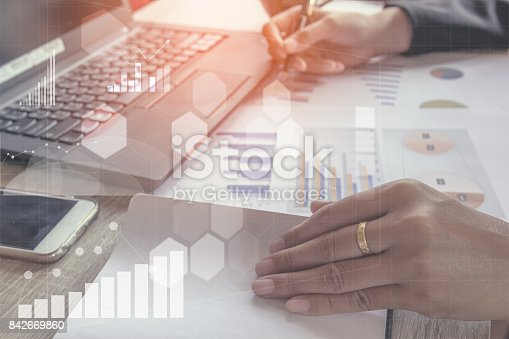 istock Young finance market analyst working at office at white table.Businessman analyze document and the calculator in hands.Graphs and diagram 842669860