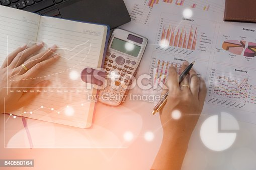 istock Young finance market analyst working at office on laptop while sitting at white table.Businessman analyze document and the calculator in hands.Graphs and diagram 840550164
