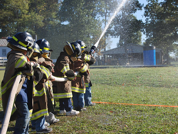 Young fire fighters stock photo