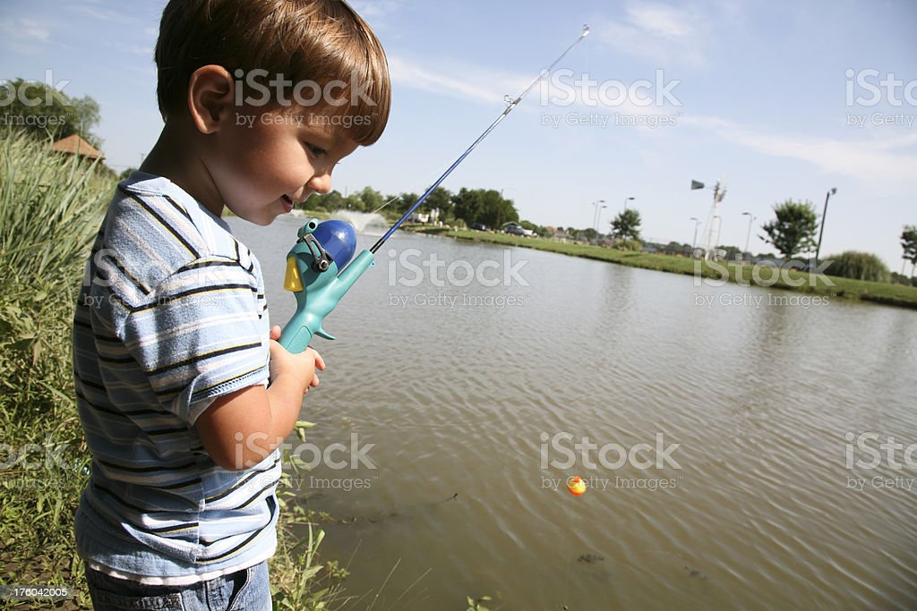 Young Fisherman Reeling In His Line royalty-free stock photo