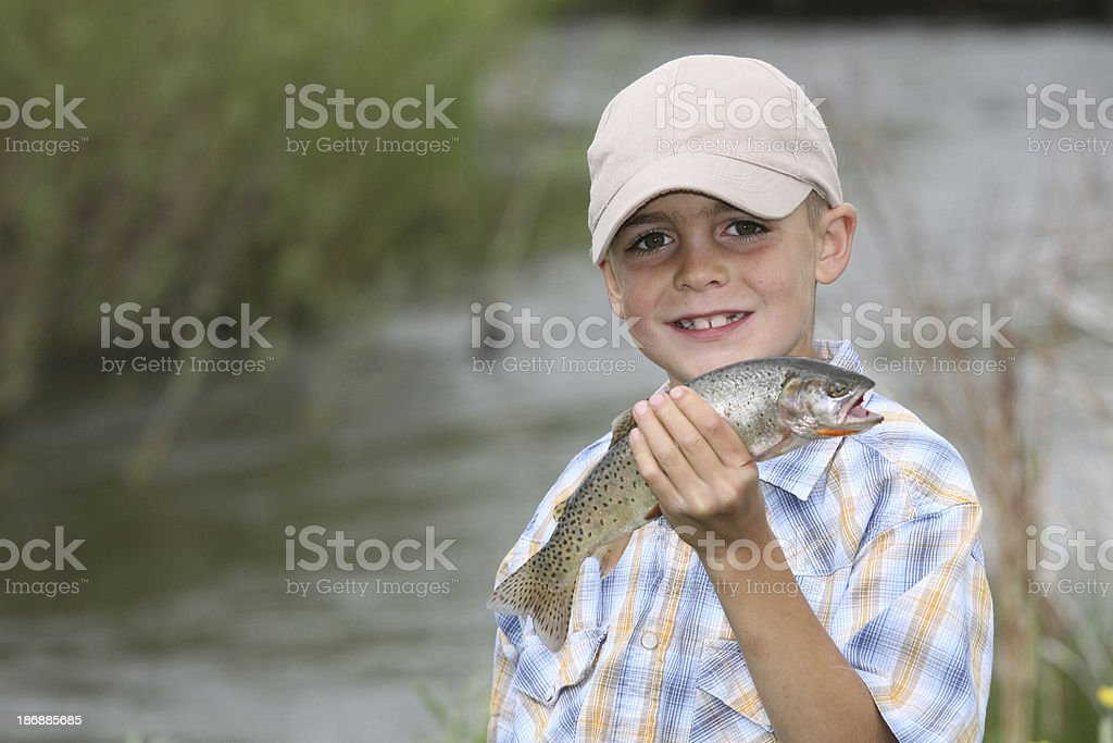 Young Fisherman with a Fish royalty-free stock photo